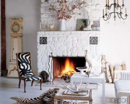 living-room-with-a-fireplace-surrunded-painted-fieldstone-554x443