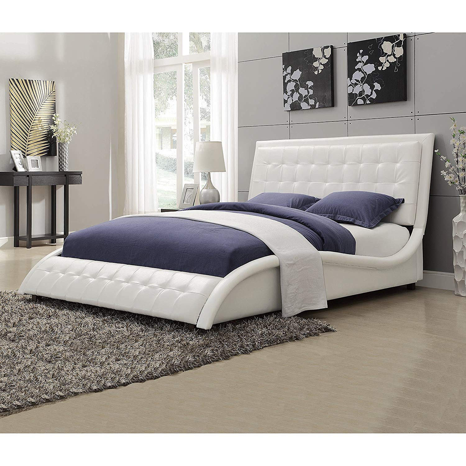 white curved bed